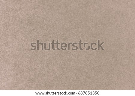 The texture of the taupe velvet. The background of taupe cloth. Luxury background of taupe velvet #687851350