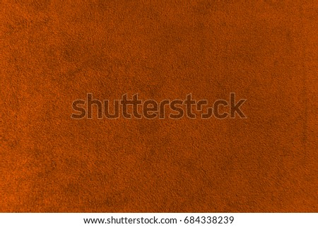 The texture of the terracotta velvet. The background of terracotta cloth. Luxury background of terracotta velvet