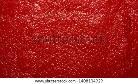 The texture of tomato paste.Ketchup background.Tomato sauce. #1408104929