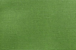 the textured background or wallpaper from rough fabric of green lime color and a blank space