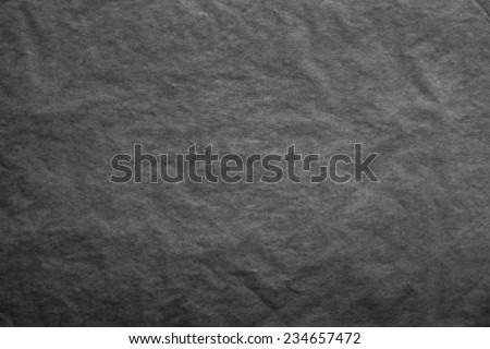 the textured clean sheet of crumpled paper of black color for pure and empty backgrounds