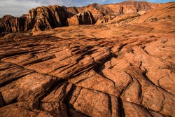 The textures and patterns of petrified sand dunes in Snow Canyon State Park.  The majority of this ancient rock is Navajo sandstone.  Various colors, red, orange, white, cream, and black are common.