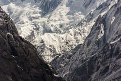 The textures of the icy, snow-covered rock walls and ridges of the Annapurna mountains in the Nepal Himalaya.