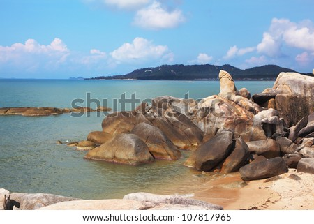 The Thai island Samui. A picturesque heap of rocks on the seacoast, shined with the sunset sun