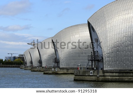 The Thames Barrier in London England. The Thames Barrier is the world's second largest movable flood barrier