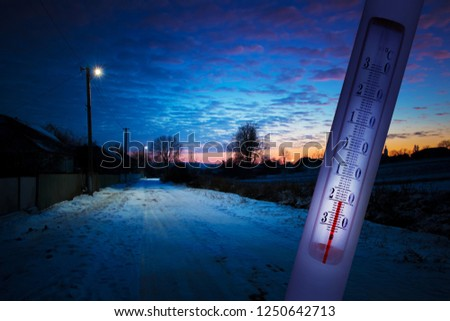 The thermometer shows minus 20 degrees Celsius. Lowering the temperature in the evening in the winter. Cold north winter