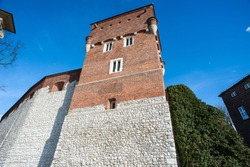 The Thieves Tower, Wawel Castle, Krakow silhouetted against deep blue sky background. Built in the 14th century to hold common criminals.