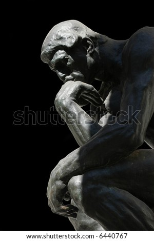 The Thinker, famous statue by Auguste Rodin, isolated on black