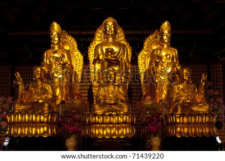 The three Chinese Buddha in the temple of Thailand