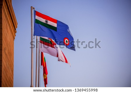 The three flags of the three Armed Forces of India; the Indian Army, Indian Navy and Indian Air Force at India gate (war memorial) located astride the Rajpath or formerly Kingsway at New Delhi, India. #1369455998