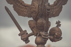 the three-headed eagle with sword and sceptre of power symbol of tsarist Russia