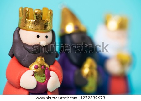 the three wise men, melchior, caspar and balthazar, on a blue background