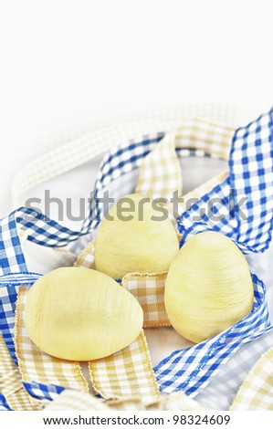 The three yellow eggs with checked ribbon