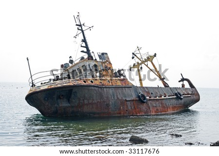 The thrown old ship has sat down on a bank - stock photo