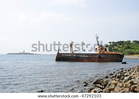 The thrown old ship has sat down on a bank