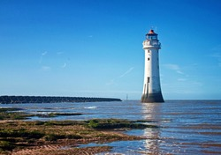 The tide comes in at Perch Rock lighthouse, New Brighton beach