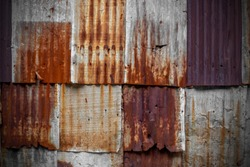 The tin roof background with the rust and nails hole by vintage style.