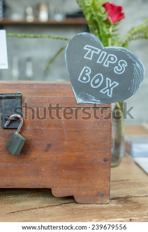 The tips box for good service in restaurant. Tips is a sum of money customarily given by a client or customer to a service worker, in addition to the basic price. Сток-фото ©