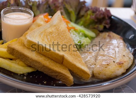 The Toast and Dolly fish steak.(closeup focus center ) #428573920