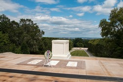 The Tomb of the Unknown Soldier at Arlington National Cemetery stands atop a hill overlooking Washington, D.C.