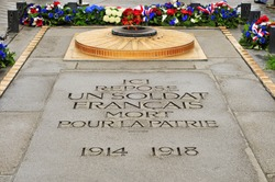the Tomb of the Unknown Soldier from World War I beneath the Arc de Triomphe, in Paris, France