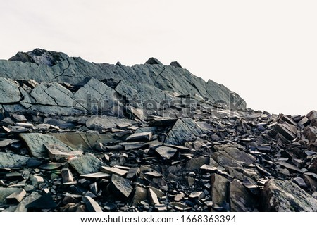 The top of a rocky mountain range. Gray flat stones. Rocky rock Stock photo ©