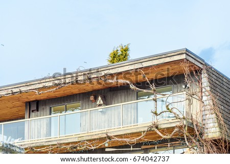 The top of the house or apartment building with nice window. #674042737