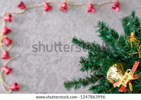 The top of the pine tree was adorned with leaves of pine and abundant gifts. Look from the tall corners of the pines down to the gray granite backgrounds in the Christmas season. #1247863996