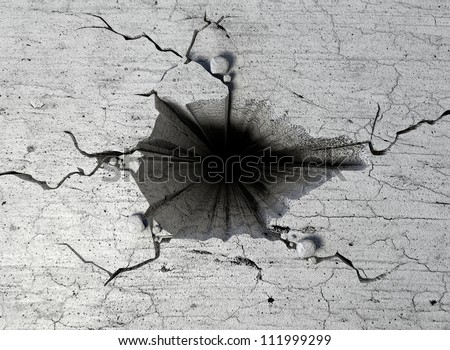 The top view of an infintely deep hole in a flat piece of cracked stone