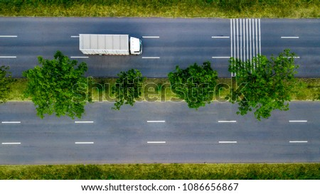 The top view of transport truck in the main road.