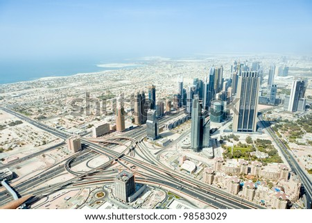 The top view on Dubai from the highest tower in the world, Burj Khalifa (828 metres). United Arab Emirates.