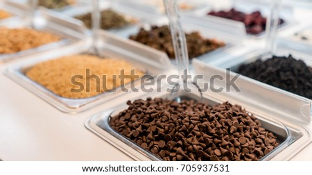 The toppings at an ice cream parlor - food and drinks concepts. #705937531