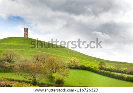 the tor glastonbury south england an ancient neolithic pagan mound with medieval church tower