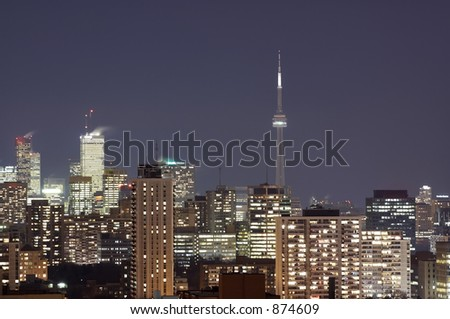 The Toronto skyline at night with the CN Tower in the background.