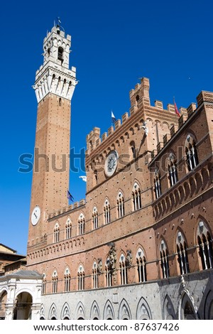 The Torre del Mangia on the Piazzo del Campo (square) in the city of Siena in Tuscany in Italy.