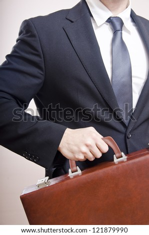 The torso of business on a beige background,