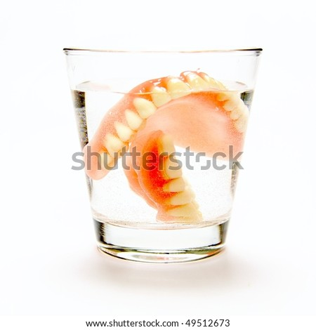 The total denture in a glass of water