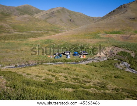 The tourist camp in the mountains, tents and cars
