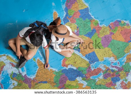 The tourist Planning a tour around the world #386563135