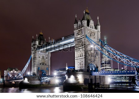 the tower bridge illuminated seen from northbank