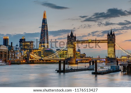 The Tower Bridge in London after sunset with the Shard in the back