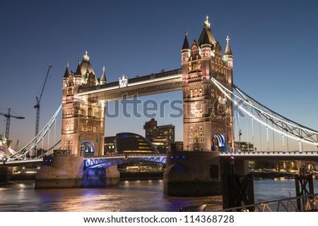 The Tower bridge in London illuminated at night