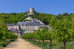 The tower of Chateau de La Roche-Guyon is perched atop the hill above the new chateau and garden