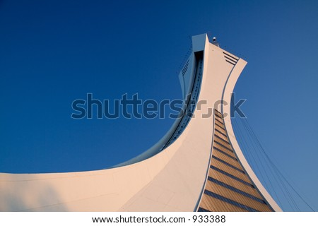 The tower of the Montreal Olympic Stadium is the tallest inclined tower in the world. Image taken at dusk.
