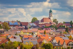 The town of Dettingen in Baden-Württemberg, Germany. Small german village. Cloudy sky, bright sunny summer day. Travel, tourism concept.