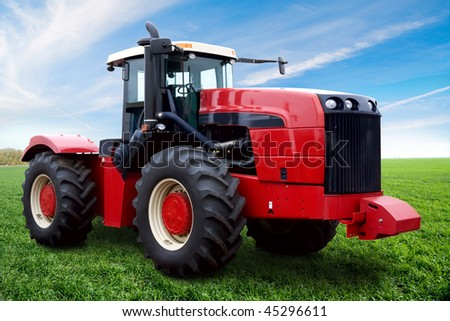 The Tractor on a green field