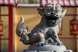 The traditional buddhist statue of snow lion in the yard of Buddhist temple in St. Petersburg, Russia. This beautiful religious building (The Datsan Gunzechoinei) is located on Primorsky Avenue.