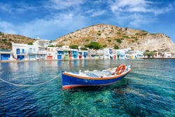The traditional fishing village of Klima on the Greek island of Milos with emerald sea and colourful boathouses, called syrmata, directly by the water, summer in Greece
