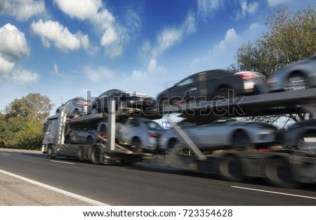 The trailer transports cars on highway stock photo