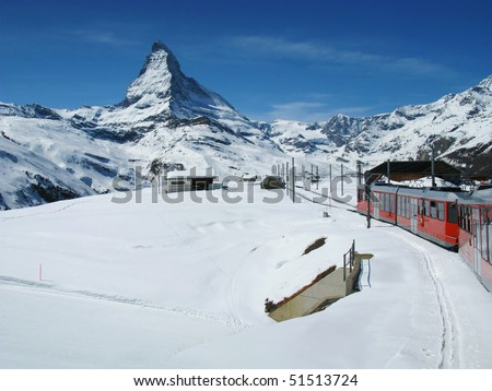 The train, at the Swiss Alps with the Matterhorn in the background